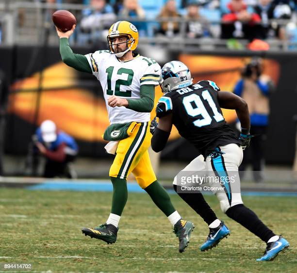 Green Bay Packers quarterback Aaron Rodgers gets pressured by Carolina Panthers defensive end Bryan Cox Jr in the second half on Sunday Dec 17 2017...