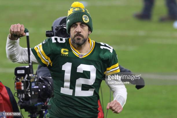 Green Bay Packers quarterback Aaron Rodgers gives a fist pump to the crowd during a NFL Divisional Playoff game between the Green Bay Packers and the...