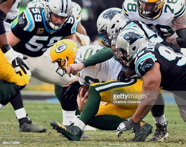 Green Bay Packers quarterback Aaron Rodgers goes down under the pressure of Carolina Panthers middle linebacker Luke Kuechly outside linebacker...