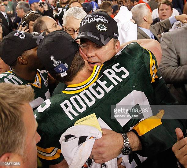 Green Bay Packers quarterback Aaron Rodgers hugs Green Bay Packers head coach Mike McCarthy at the end of Super Bowl XLV where the Green Bay Packers...