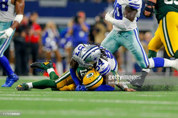 Green Bay Packers quarterback Aaron Rodgers is sacked by Dallas Cowboys middle linebacker Jaylon Smith during the game between the Green Bay Packers...