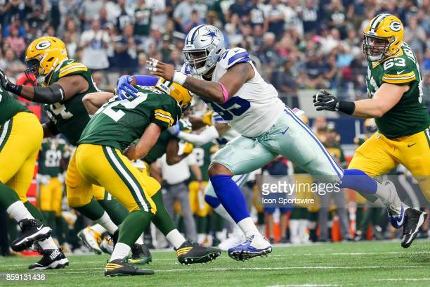 Green Bay Packers quarterback Aaron Rodgers is sacked by Dallas Cowboys defensive tackle David Irving during the football game between the Green Bay...