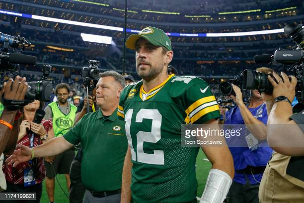 Green Bay Packers quarterback Aaron Rodgers is surrounded by media after the game between the Green Bay Packers and Dallas Cowboys on October 6, 2019...