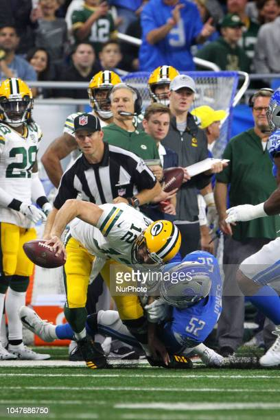 Green Bay Packers quarterback Aaron Rodgers is tackled by Detroit Lions linebacker Christian Jones during the first half of an NFL football game...