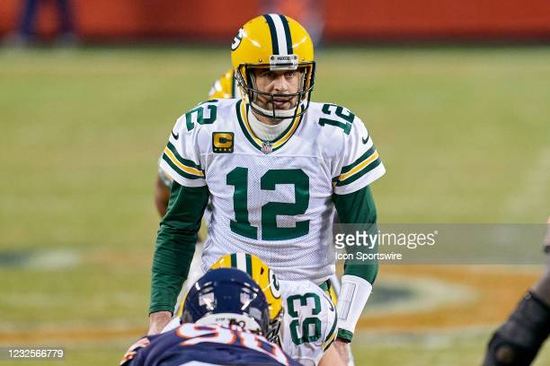 Green Bay Packers quarterback Aaron Rodgers looks on before taking the snap in action during a game between the Chicago Bears and the Green Bay...