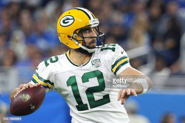 Green Bay Packers quarterback Aaron Rodgers passes the ball during the second half of an NFL football game against the Green Bay Packers in Detroit...