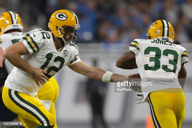 Green Bay Packers quarterback Aaron Rodgers passes to running back Aaron Jones during the first half of an NFL football game against the Detroit...