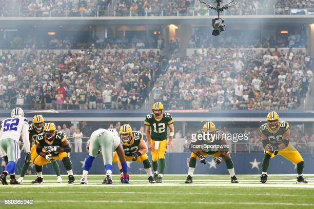 Green Bay Packers quarterback Aaron Rodgers prepares for the snap during the football game between the Green Bay Packers and Dallas Cowboys on...