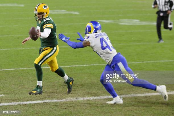 Green Bay Packers quarterback Aaron Rodgers scores in front of Los Angeles Rams free safety John Johnson during a NFL Divisional Playoff game between...