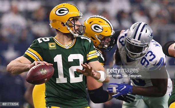 Green Bay Packers quarterback Aaron Rodgers throws in the second quarter against the Dallas Cowboys in the NFL divisional playoffs on Sunday Jan 15...