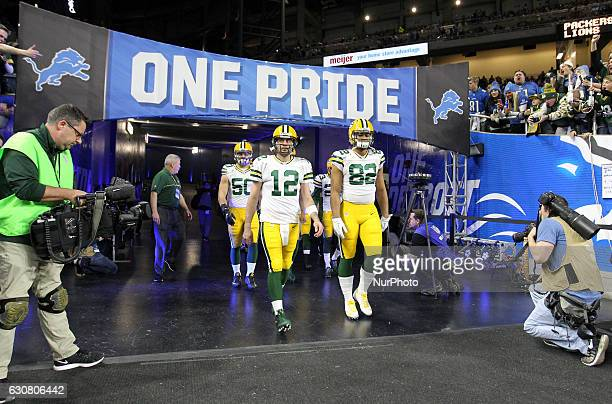 Green Bay Packers quarterback Aaron Rodgers tight end Richard Rodgers and inside linebacker Blake Martinez walk out the tunnel for pregame warmups...