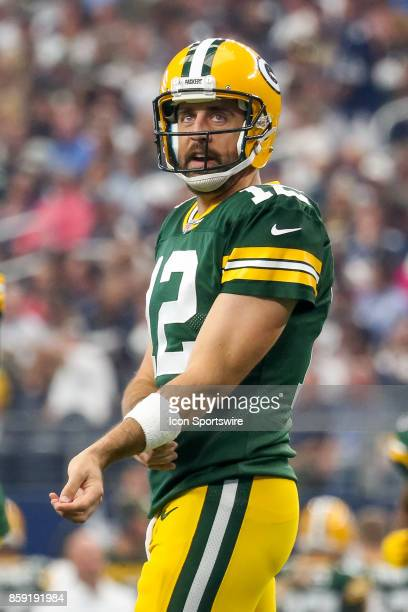 Green Bay Packers quarterback Aaron Rodgers walks to the huddle during the football game between the Green Bay Packers and Dallas Cowboys on October...