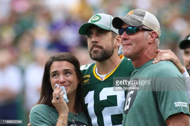 Green Bay Packers quarterback Aaron Rodgers watches a tribute to Bart Starr with Leann Nelson and Brett Favre during a game between the Green Bay...