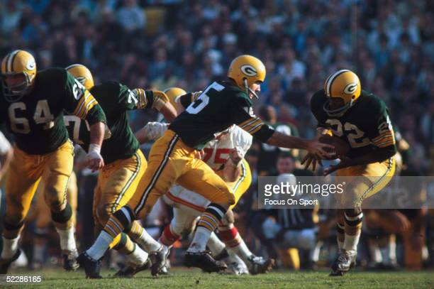 Green Bay Packers' quarterback Bart Starr hands off to Elijah Pitts during Super Bowl I against the Kansas City Chiefs at Memorial Coliseum on...