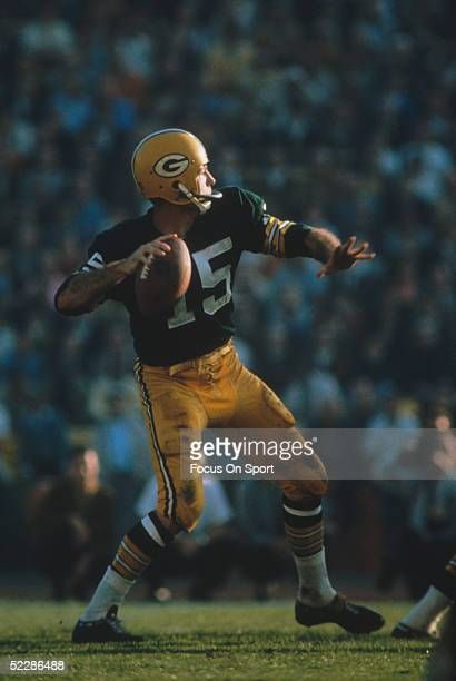Green Bay Packers' quarterback Bart Starr steps back to pass against the Kansas City Chiefs' during Super Bowl I at Memorial Coliseum on January 15...