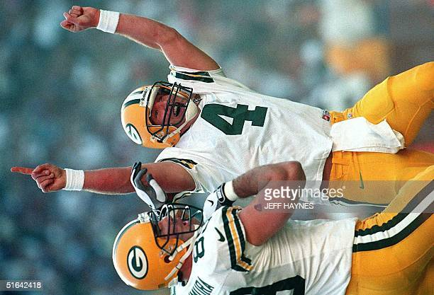 Green Bay Packers quarterback Brett Favre celebrates after throwing a 22-yard touchdown pass to Antonio Freeman in the first quarter against the...