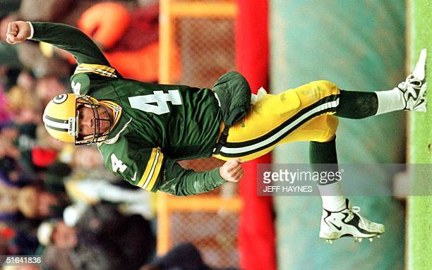 Green Bay Packers quarterback Brett Favre celebrates after throwing one of two touchdowns against the Buffalo Bills 20 December during the first half...
