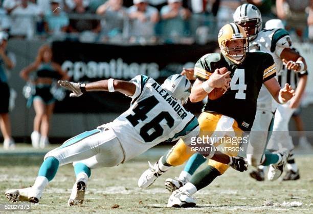 Green Bay Packers quarterback Brett Favre changes direction to avoid Carolina Panthers defender Brent Alexander during the fourth quarter of their 27...