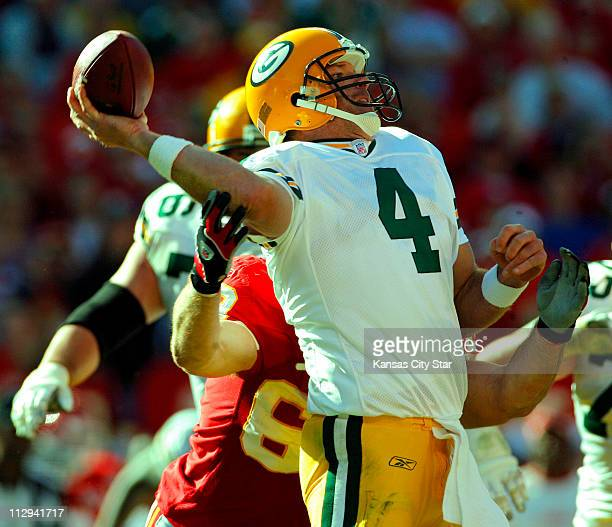 Green Bay Packers quarterback Brett Favre gets a pass off before Kansas City Chiefs defensive end Jared Allen could get to him in the third quarter...