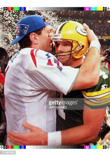 Green Bay Packers quarterback Brett Favre gets hugged by quarterback Drew Bledsoe of the New England Patriots 26 January after Super Bowl XXXI at the...