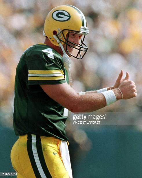 Green Bay Packers quarterback Brett Favre gives a double thumbs up after making his second touchdown pass to teammate William Henderson in the fourth...