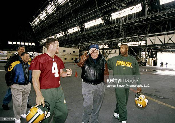 Green Bay Packers quarterback Brett Favre Hall of Fame coach John Madden and defensive end Reggie White before a 3121 win over the Buffalo Bills on...
