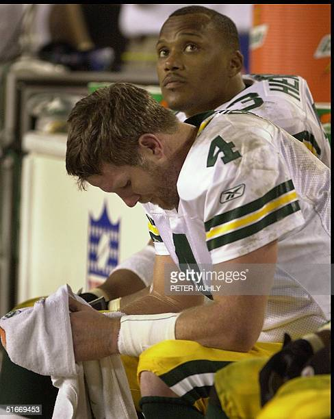 Green Bay Packers quarterback Brett Favre hangs his head 24 November 2002 during the fourth quarter at Raymond James Stadium in Tampa Florida as...