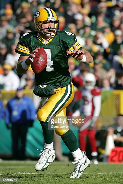 Green Bay Packers quarterback Brett Favre looks for a receiver downfield during game against the Arizona Cardinals at Lambeau Field in Green Bay...