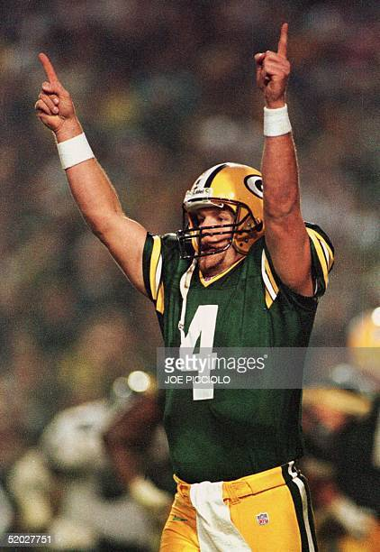 Green Bay Packers' quarterback Brett Favre signals a touchdown after completing a touchdown pass to fullback William Henderson during the second...