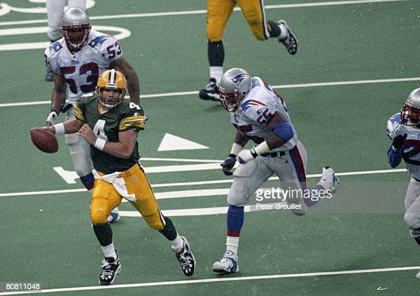 Green Bay Packers quarterback Brett Favre tries to get away from pressure from New England Patriots defensive end Willie McGinest during Super Bowl...