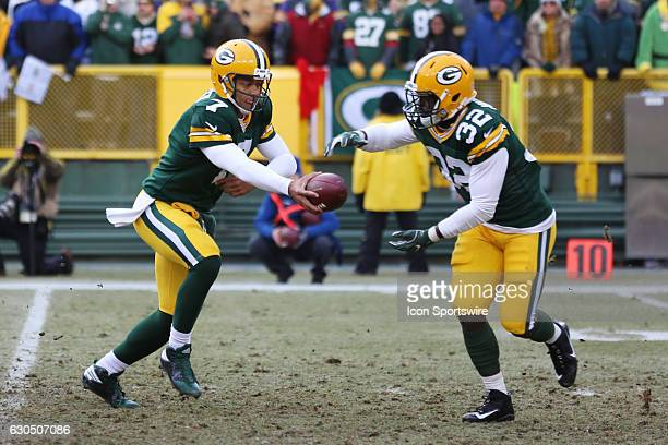 Green Bay Packers Quarterback Brett Hundley hands off to Green Bay Packers Running Back Christine Michael during the game between the Green Bay...