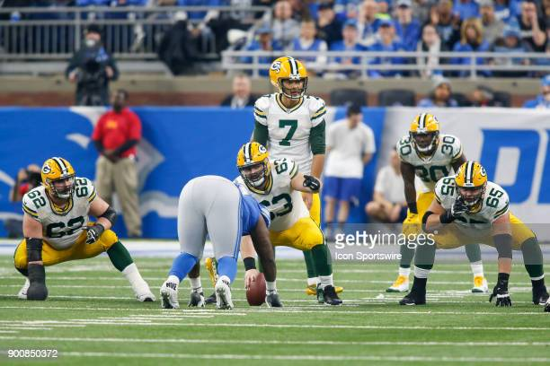 Green Bay Packers quarterback Brett Hundley looks over the defense while Green Bay Packers guard Lucas Patrick center Corey Linsley and guard Lane...