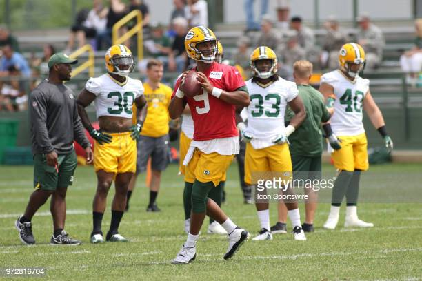 Green Bay Packers quarterback DeShone Kizer looks downfield during Green Bay Packers minicamp at Ray Nitschke Field on June 12 2018 in Green Bay WI