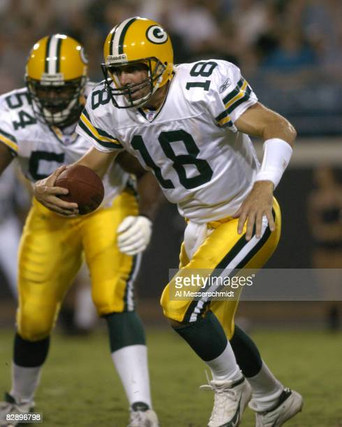 Green Bay Packers quarterback Doug Pederson scrambles against the pass rush during an August 27 2004 NFL preseason game against the Jacksonville...