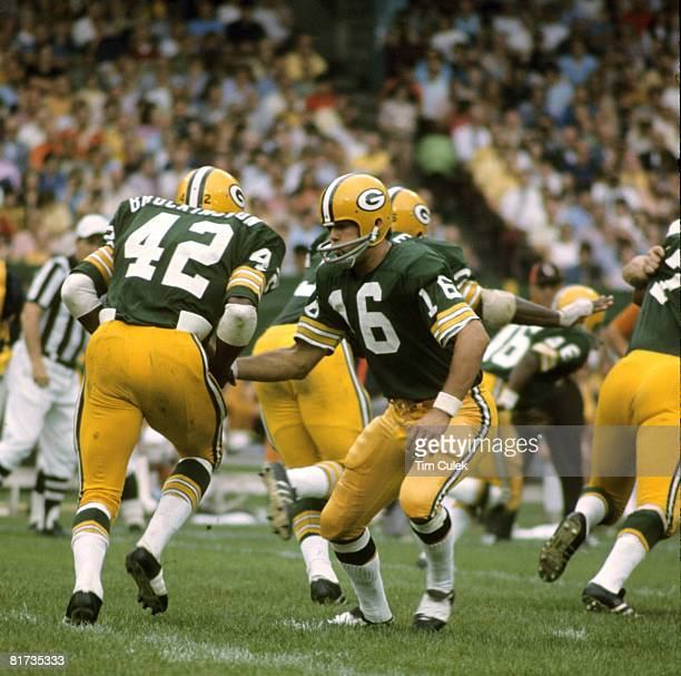 Green Bay Packers quarterback Scott Hunter hands off to running back John Brockington during a 2610 victory over the Cleveland Browns on September 17...