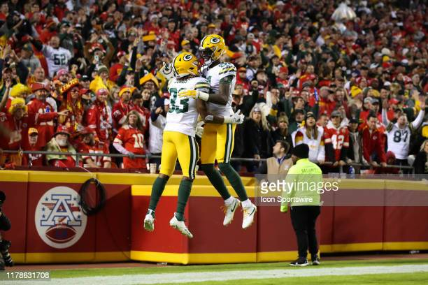 Green Bay Packers running back Aaron Jones and wide receiver Geronimo Allison leap in celebration after a touchdown reception by Jones in the first...
