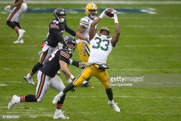 Green Bay Packers running back Aaron Jones beats Chicago Bears inside linebacker Nick Kwiatkoski to catch a pass during an NFL football game between...