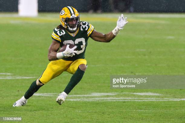 Green Bay Packers running back Aaron Jones cuts back during a NFL Divisional Playoff game between the Green Bay Packers and the Los Angeles Rams at...