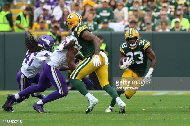 Green Bay Packers running back Aaron Jones cuts back to an open hole during a game between the Green Bay Packers and the Minnesota Vikings on...
