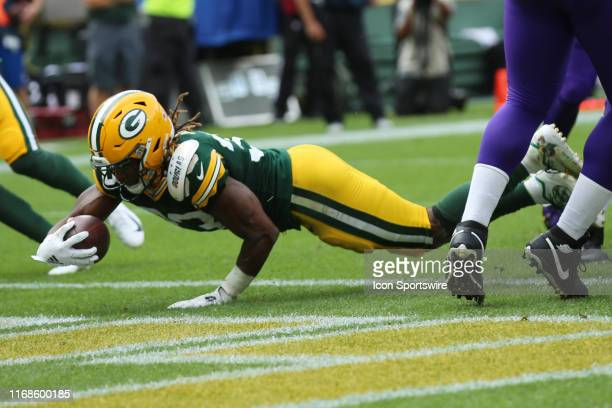 Green Bay Packers running back Aaron Jones dives for a touchdown during a game between the Green Bay Packers and the Minnesota Vikings on September...