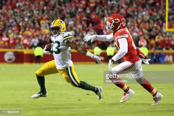 Green Bay Packers running back Aaron Jones is chased by Kansas City Chiefs defensive back Bashaud Breeland during a run in the third quarter of an...