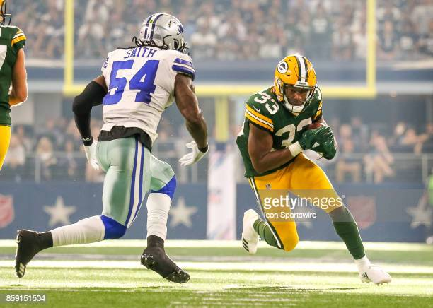 Green Bay Packers running back Aaron Jones is pursued by Dallas Cowboys outside linebacker Jaylon Smith during the football game between the Green...