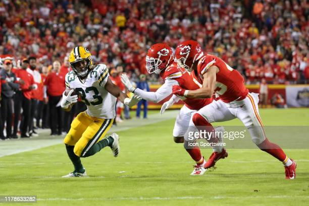 Green Bay Packers running back Aaron Jones is pursued by Kansas City Chiefs defensive backs Bashaud Breeland and Daniel Sorensen during a run in the...