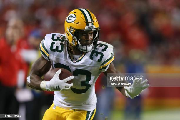 Green Bay Packers running back Aaron Jones looks to stiff arm the defense during a run in the third quarter of an NFL game between the Green Bay...
