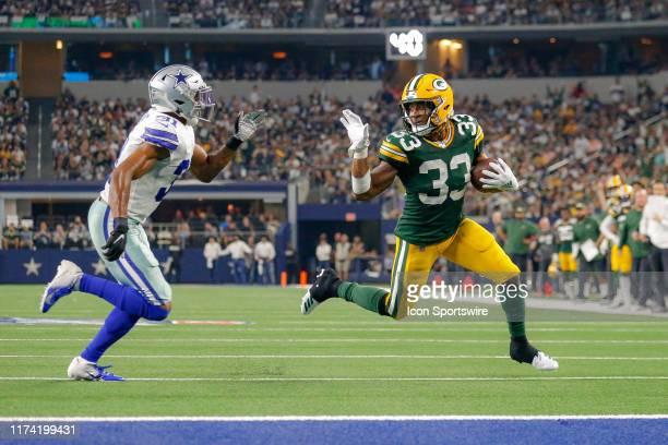 Green Bay Packers running back Aaron Jones makes a waving gesture at Dallas Cowboys cornerback Byron Jones as he rushes for a touchdown during the...