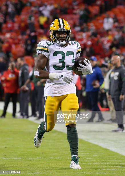 Green Bay Packers running back Aaron Jones runs with the ball before an NFL game between the Green Bay Packers and Kansas City Chiefs on October 27...