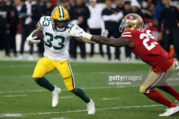 Green Bay Packers Running Back Aaron Jones rushes with the ball during an NFC Conference Championship game between the San Francisco 49ers and the...