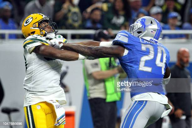 Green Bay Packers running back Aaron Jones scuffles with Detroit Lions cornerback Nevin Lawson during the first half of an NFL football game against...