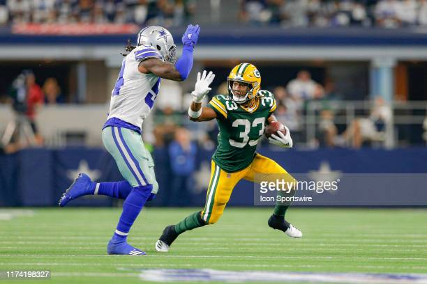 Green Bay Packers running back Aaron Jones stiff arms Dallas Cowboys middle linebacker Jaylon Smith during the game between the Green Bay Packers and...