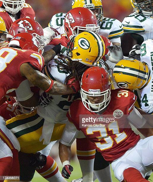 Green Bay Packers running back Alex Green is brought down by the Kansas City Chiefs defense including free safety Tysyn Hartman in the second quarter...